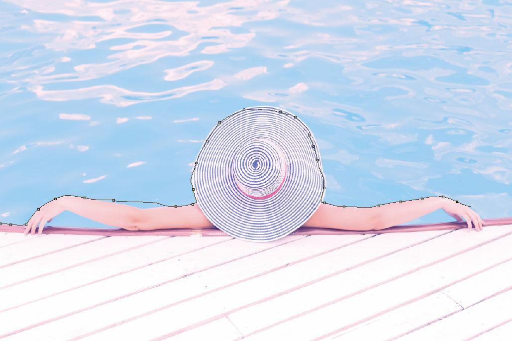 person with hat by pool in Photoshop with magnetic Lasso
