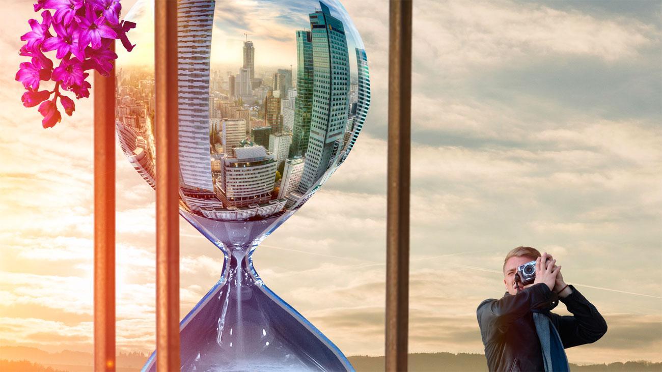 an hourglass with a skyscraper scene in it