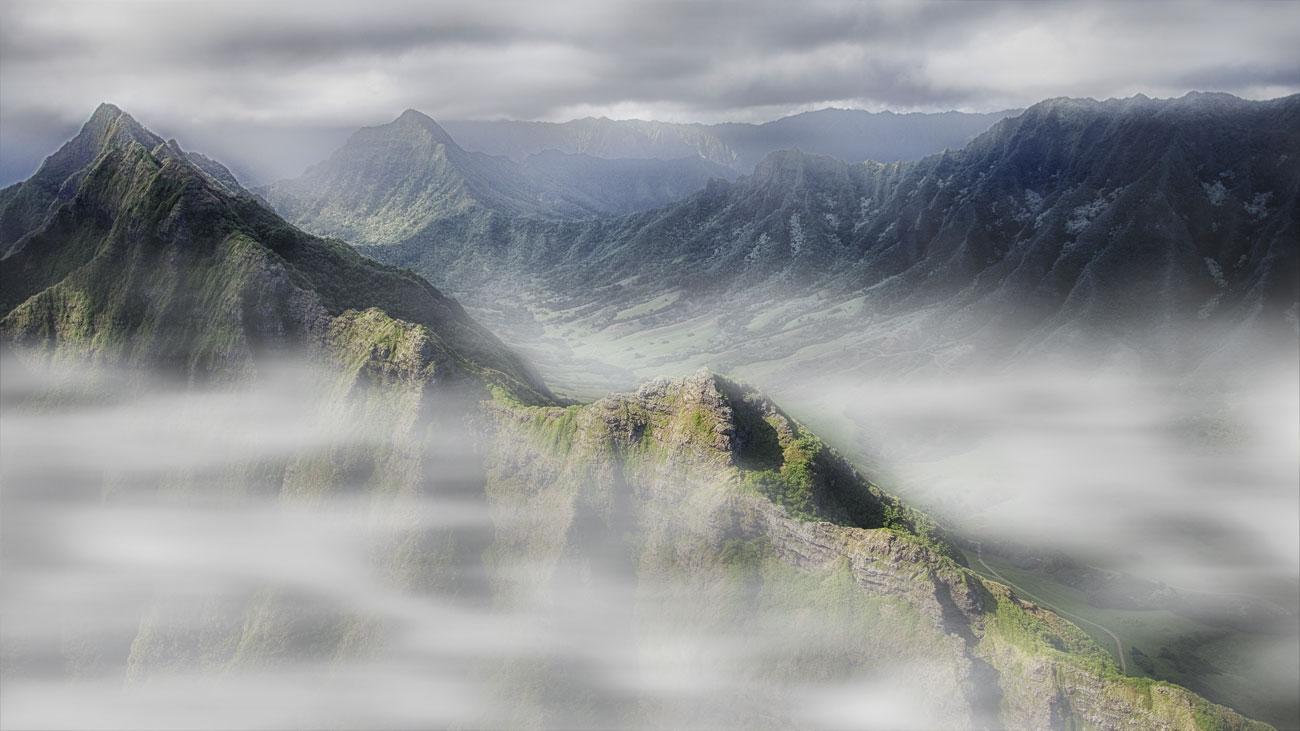 clouds over a hillside