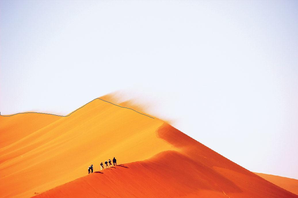 image of figures on a sand dune