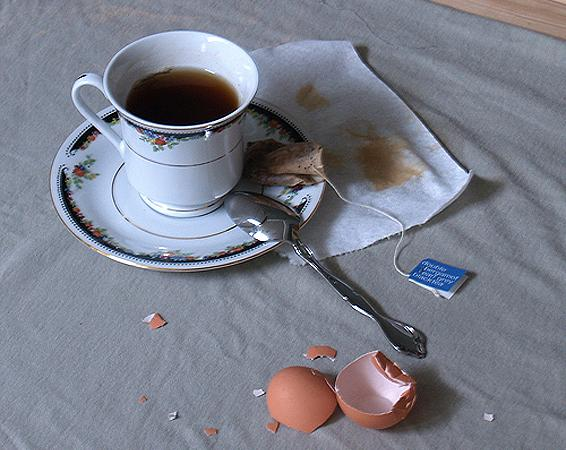 photo of a teacup with a broken egg