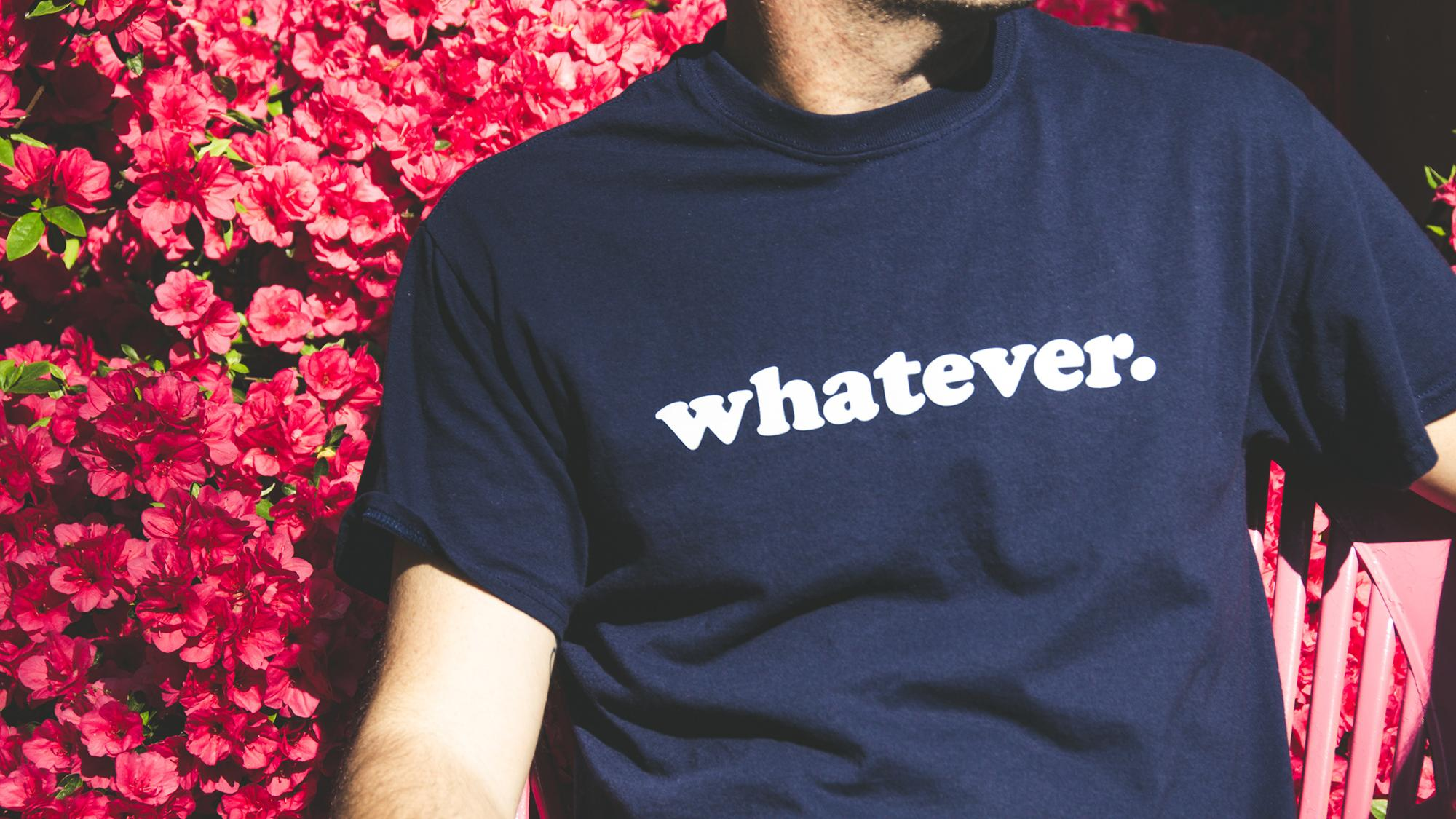 person with t-shirt that says 'whatever' on it