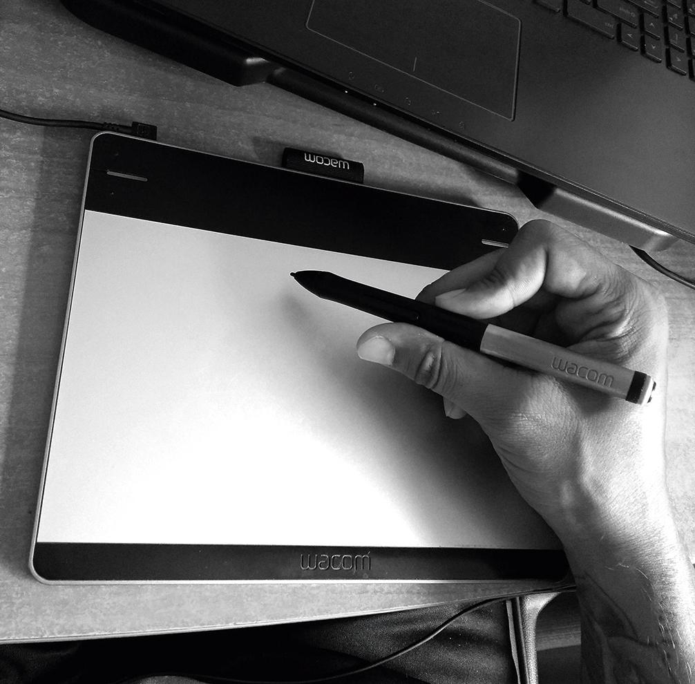 person drawing on Wacom tablet