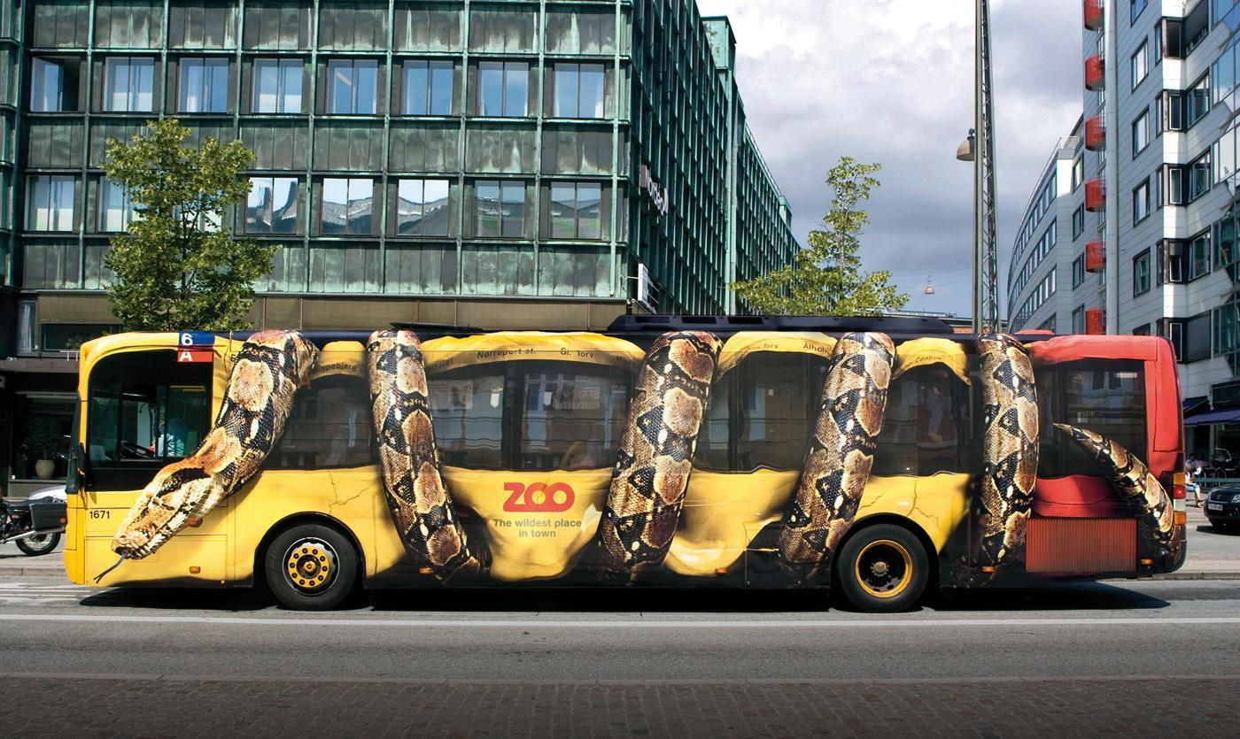 Bus wrap that looks like a snake crushing the vehicle