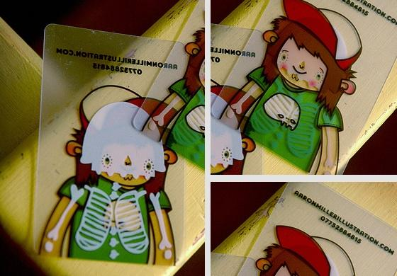 Plastic business cards show skeleton cartoon one side and clothed character on the other