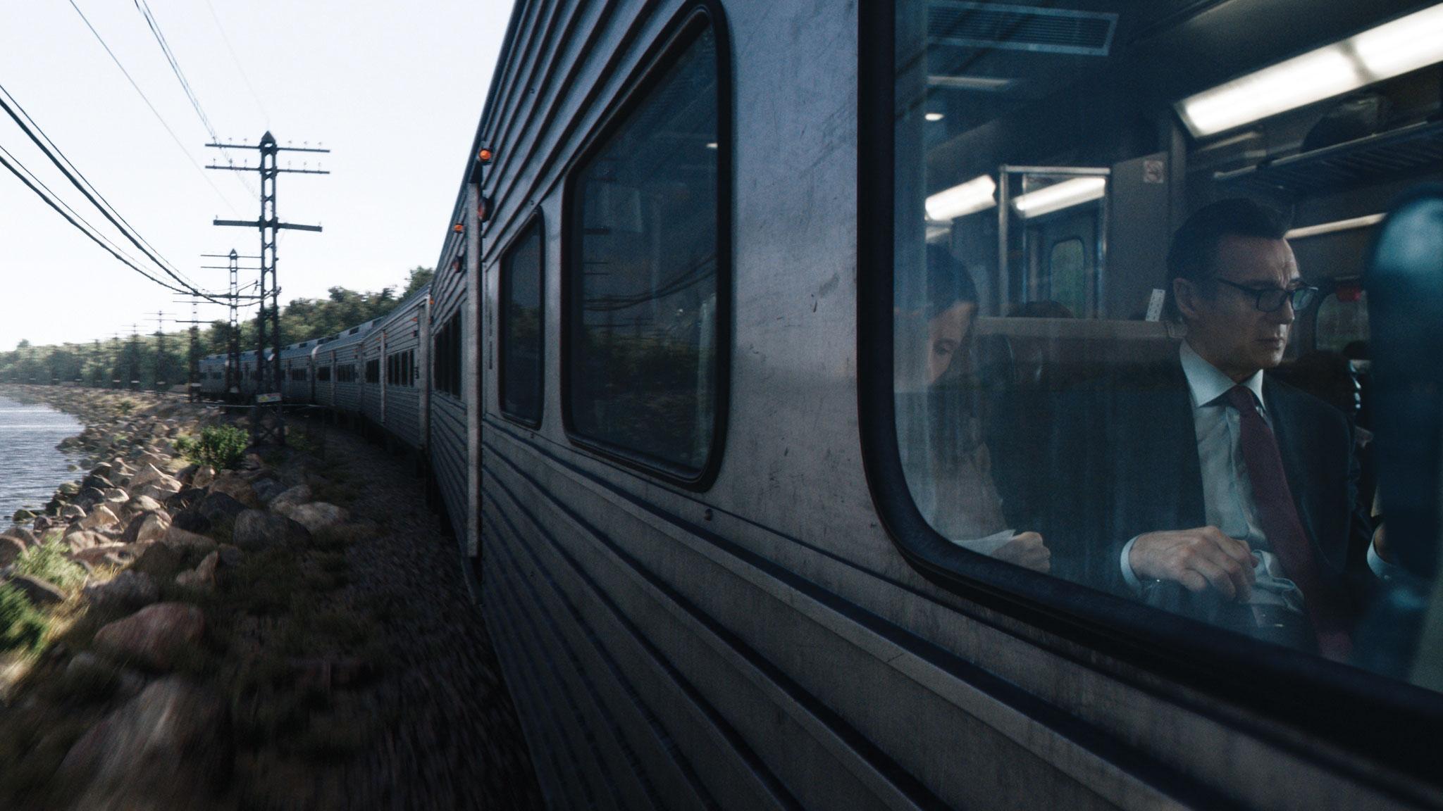 Shot of Liam Neeson in a train